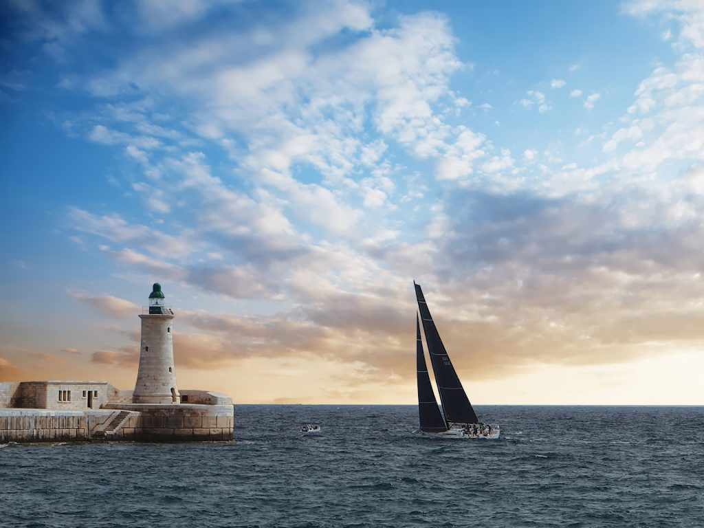 Malta lighthouse sailing yacht